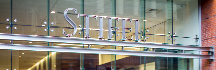 Stifel logo over entry to headquarters building in St. Louis.